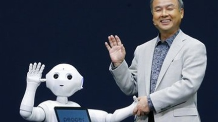 Softbank Corp. President Masayoshi Son, right, and Pepper, a newly developed robot, wave together during a press event in Urayasu, near Tokyo. AP Photo