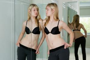 Woman-looking-in-the-mirror-jpg