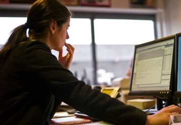 Woman Reading Email --- Image by © Helen King/Corbis